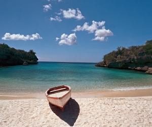 Boat-on-sandy-beach-Curacao-Island.jpg